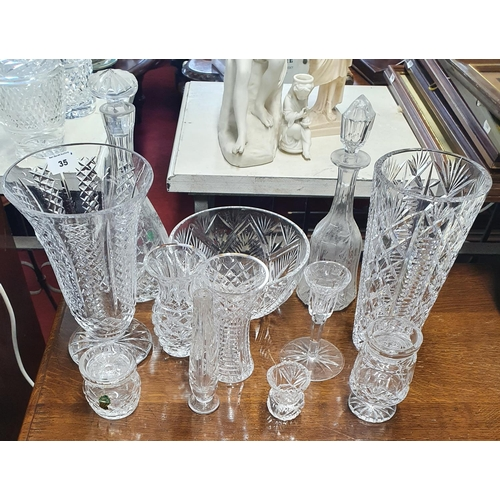 35 - A large quantity of primarily Waterford Crystal to include vases, bowl etc.