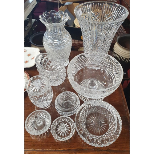38 - A large quantity of primarily Waterford Crystal to include vases, bowl etc.
