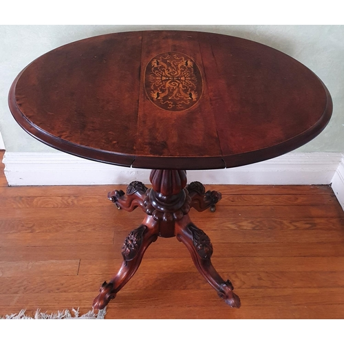 11 - A late 19th early 20th Century oval Walnut Side Table with drop leaves on a turned carved base, carv...