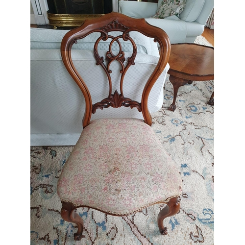 13 - A lovely pair of 19th Century Walnut Chairs with highly pierced backs and carved supports. Back heig...