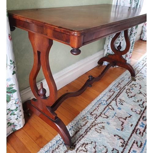 15 - A 19th Century Walnut rectangular Centre Table with an inlaid top, lyre ends and a stretcher base. 1...