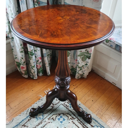 17 - A 19th Century Walnut Crossbanded Circular Wine Table with a highly carved fluted tripod base and fl...