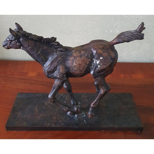 25 - A Bronze Sculpture of a Racehorse. Signed Arnup. H23 x D10 X W33cm approx.