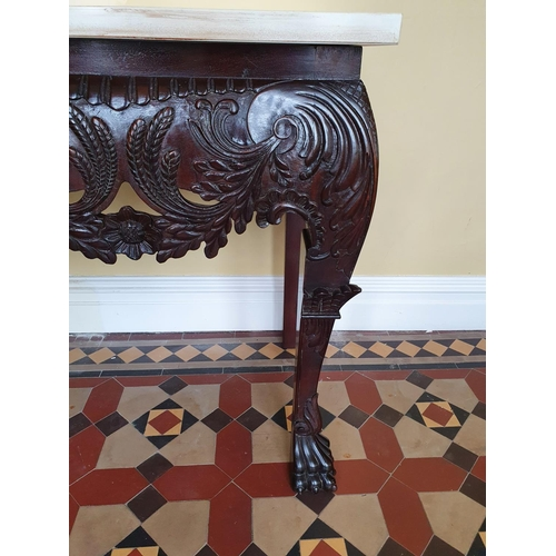 39 - A fantastic Irish Mask Table in the Georgian style with highly carved front, hairy paw feet and marb...