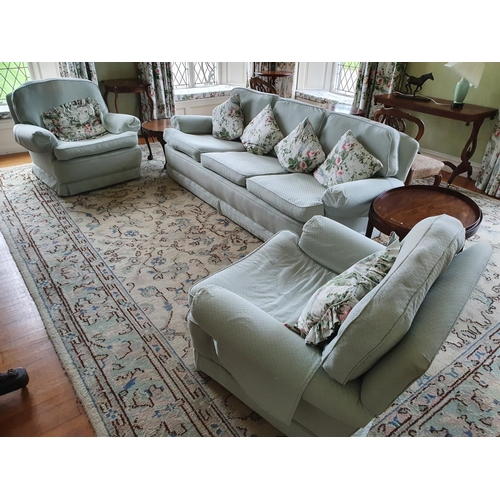 4 - A good green Upholstered three piece Suite. Couch W220 approx, a chair 97cm approx.