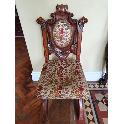 45 - A really good 19th Century Irish Oak Hall Chair with a X frame base, gargoyle support at carved back...
