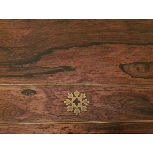 54 - A Magnificent Regency Rosewood and Brass inlaid Foldover Card table on a moulded platform base and w...