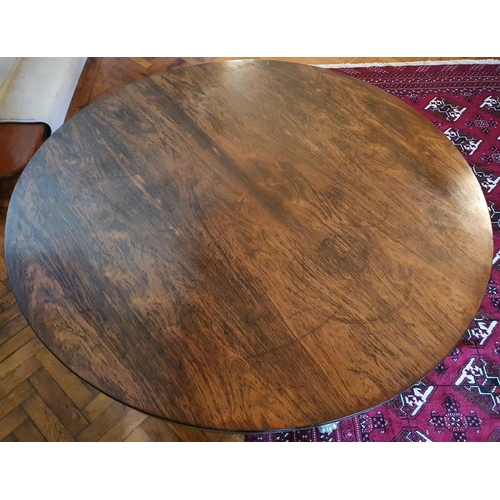 56 - A Magnificent Regency Rosewood circular Centre Library Table with Brass inlay. The Frieze profusely ...