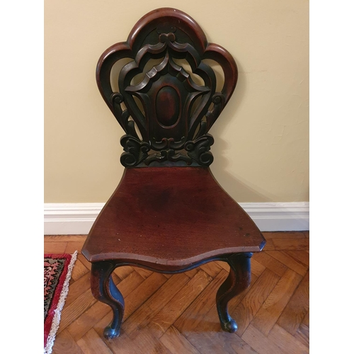 57 - A good pair of early 19th Century Mahogany Hall Chairs with highly pierced backs and heavy solid sea...