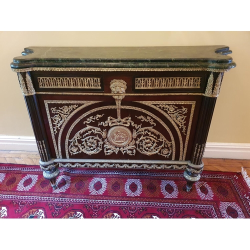 58 - A Superb pair of Mahogany Side Cabinets profusely mounted with ormolu mounts. On turned supports and...