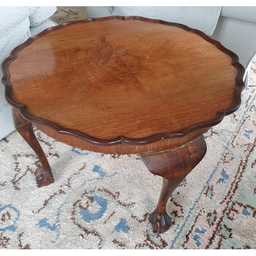 7 - An Edwardian Walnut low Side Table with scalloped edge on ball and claw feet. Diam.60 x H39cm approx...