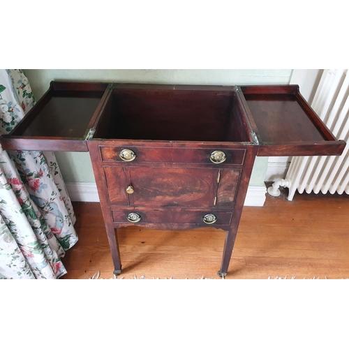 8 - A Georgian Mahogany Side/Drinks Cabinet with foldout top on brass squat castors. W56 x D46 x H89cm a...