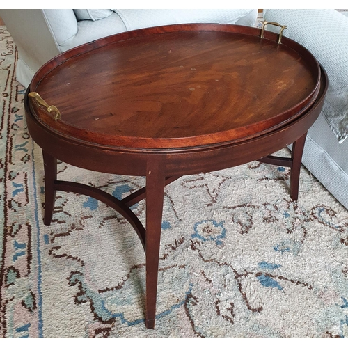 9 - A Georgian Mahogany oval Butlers Table with gallery topped tray on a later base. 76 x 59 x H48cm app...