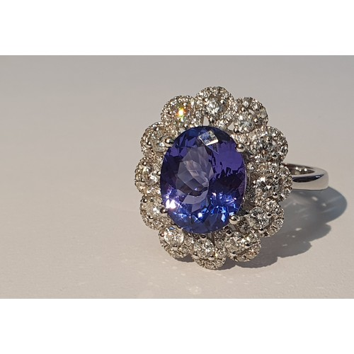 1 - An 18ct Gold tanzanite and diamond dress ring. Tanzanite weight 3.71cts. Total diamond weight 0.99ct...