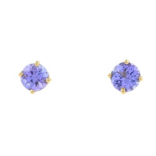 3 - A pair of tanzanite stud earrings. Stamped 14K.Diameter 0.4cm.