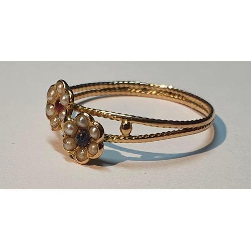 4 - A split pearl and gem-set floral dress ring. Ring size P. 1.2gms.