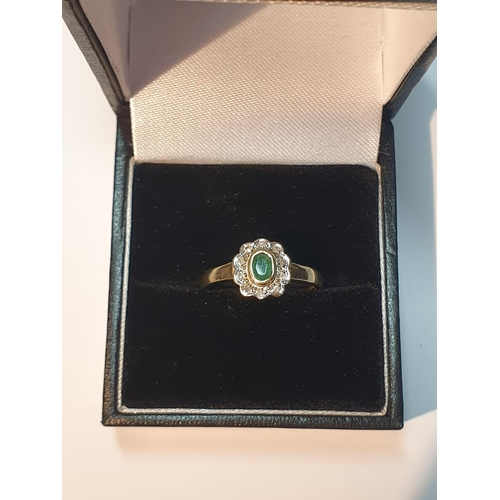 6 - 9ct gold emerald and diamond cluster ring, hallmarks for London, ring size N, 2gms.