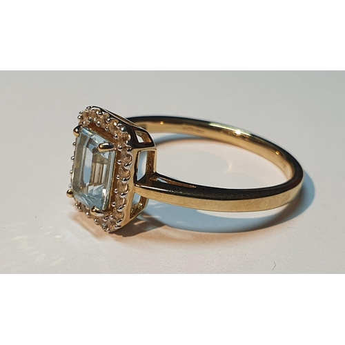 9 - A 9ct gold blue topaz cluster ring. Hallmarks for 9ct gold, partially indistinct. Ring size P. 2.7gm...