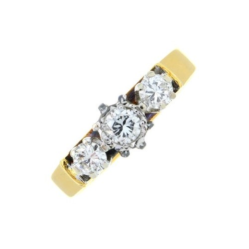 12 - An 18ct gold brilliant-cut diamond three-stone ring. Estimated total diamond weight 0.50ct, H-I colo...