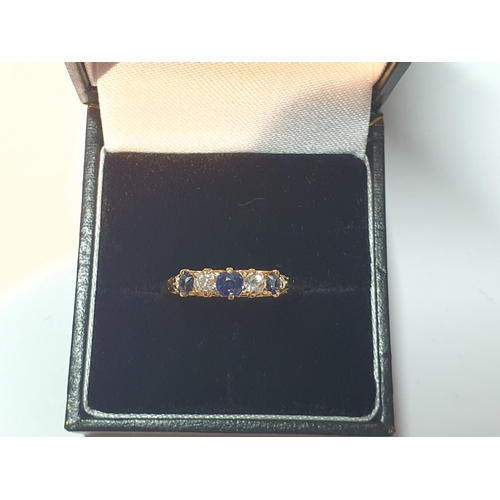 13 - An 18ct gold sapphire and old-cut diamond five-stone ring. Estimated total diamond weight 0.20ct, H-...