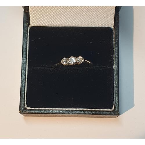 20 - A diamond three-stone ring. Estimated total diamond weight 0.35ct, principal diamond estimated H-I c...