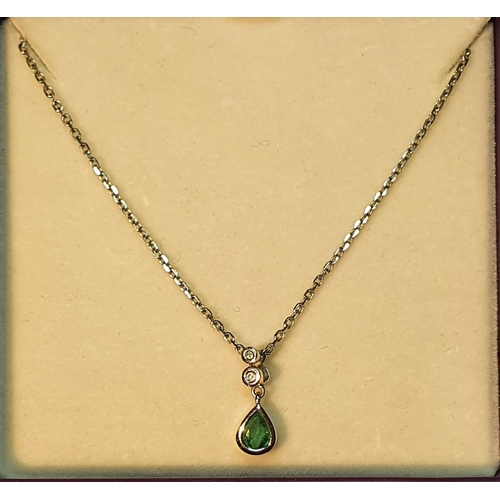 24 - Emerald and diamond pendant, suspended from a 9ct gold chain, hallmarks for Sheffield, stamped 375, ...