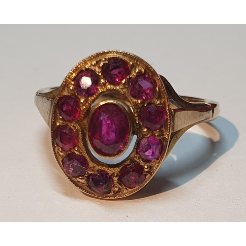 25 - Ruby cluster ring, stamped 9ct, ring size L1/2, 3.3gms.