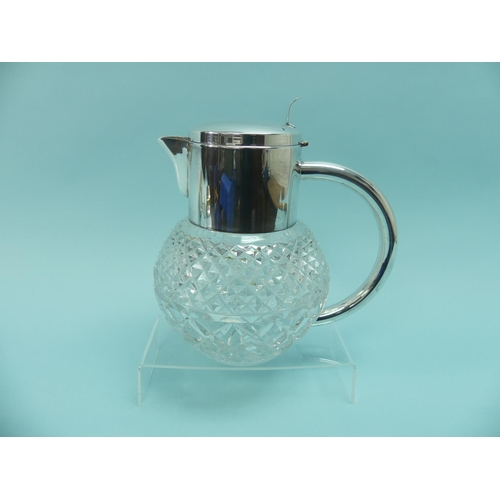 57 - A stylish silver plate mounted cut glass Lemonade Jug, the hobnail cut circular glass body with silv...