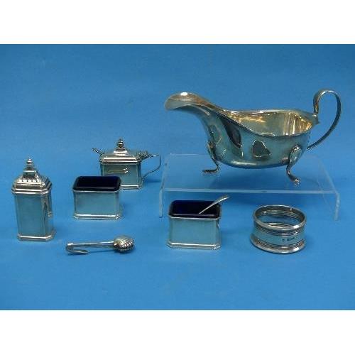 14 - A George V silver four piece Cruet Set, by alker & Hall, hallmarked Birmingham, 1927, of rectangular...