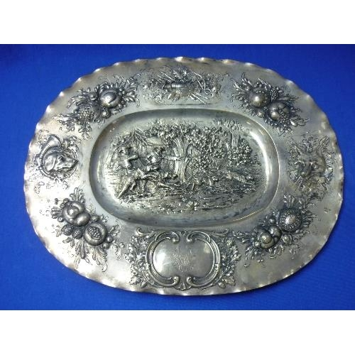 2 - An early 20thC Continental silver oval Charger, in the Dutch style with repoussé decoration, the cen...