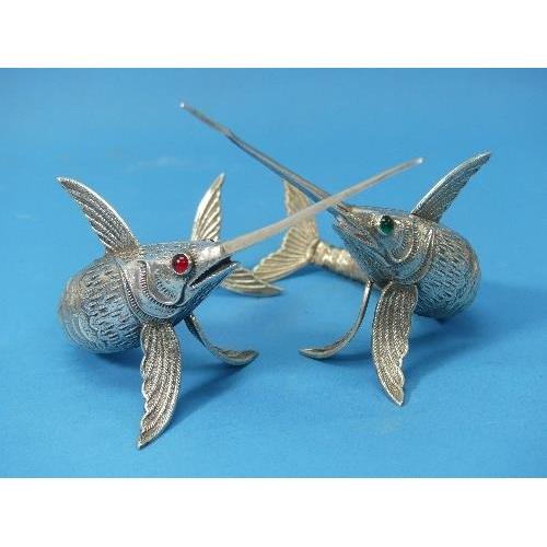 26 - A pair of Spanish silver Articulated Model Sword Fish,  marked on pectoral fins, one with green glas...