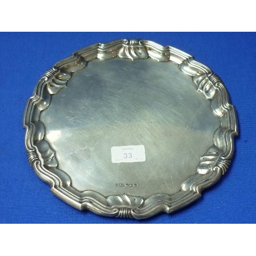 33 - A George V silver Tray, by Joseph Rodgers & Sons, hallmarked Sheffield, 1920, of shaped circular for...
