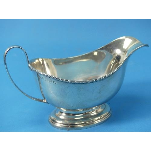 48 - A George V silver Sauce Boat, by Henry Clifford Davis, hallmarked Birmingham, 1919, of traditional f...