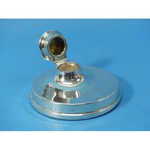 49 - A George V silver Capstan Inkwell, by William Hutton & Sons Ltd., hallmarked Birmingham, 1919, of pl...
