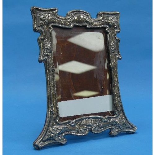 55 - An Arts & Crafts silver Easel Frame, by Sydney & Co., hallmarked Birmingham, 1903, with stylised flo...