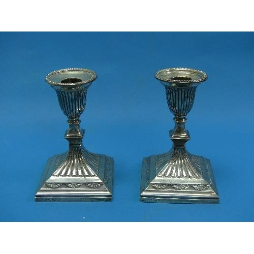 57 - A pair of Victorian silver short Candlesticks, by Hawksworth, Eyre & Co., hallmarked Sheffield, 1882...