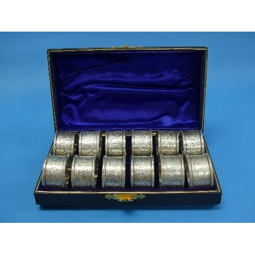 59 - A cased set of twelve late Victorian silver Napkin Rings, by Hilliard & Thomason, hallmarked Birming...