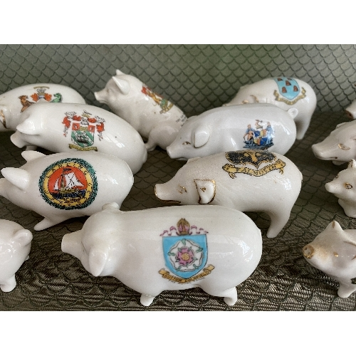 2 - A large quantity of Crested China Pigs, all painted with different crests and place names, with fact...