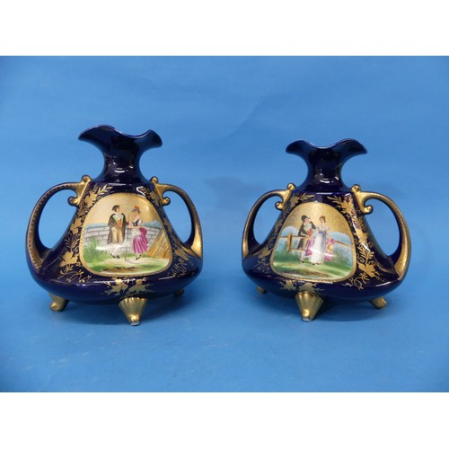 7 - A pair of early 20thC Continental porcelain Vases,the twin handled Vases, in blue ground, with cent...