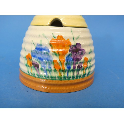 16 - An early 20thC Clarice Cliff Newport Pottery 'Spring Crocus' pattern Honey Pot, in the form of a ske...
