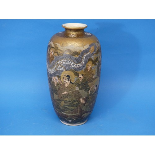 36 - An early 20thC Japanese Satsuma Vase, depicting characters' faces, dragons and temples, with a chara...