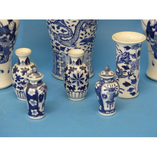 37 - A pair of early 20thC Chinese Blue and White Vases, the body decorated with warriors, with a six cha...