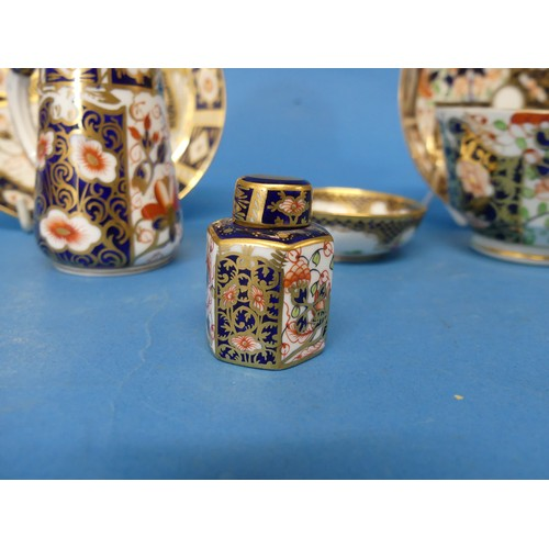 28 - A 19thC Royal Crown Derby 2451 pattern Tea Cup and Saucer,decorated in the typical imari palette, ...