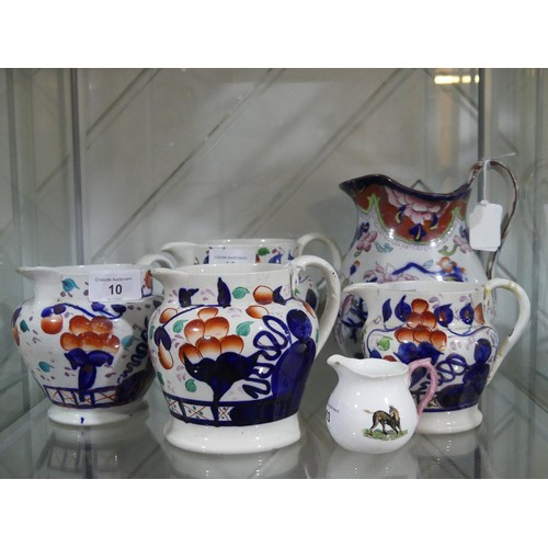 10 - Set of four graduated Staffordshire Jugs,decorated in the imari palette, together with Large Imari ...