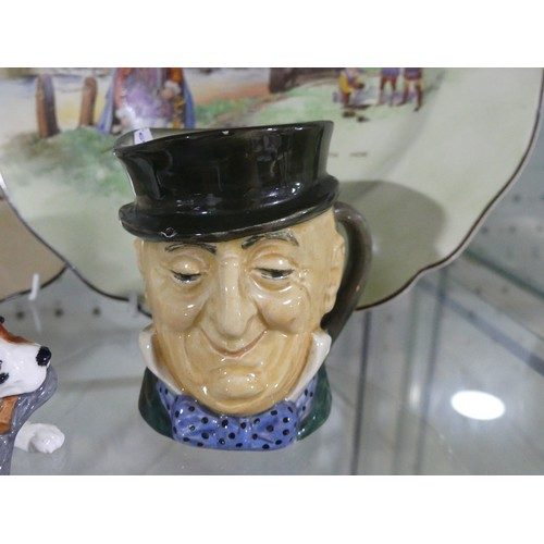 12 - A small quantity of Royal Doulton; including Seriesware plates, Toby Jug and a small Doulton dog (a ...