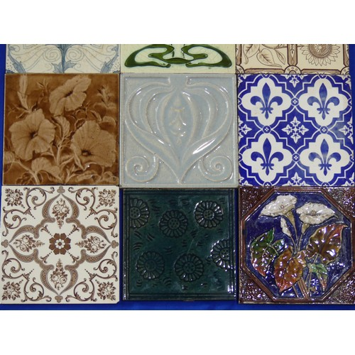 34 - A large quantity of Victorian and later Tiles,including three by Minton, one in decorated with lemo...