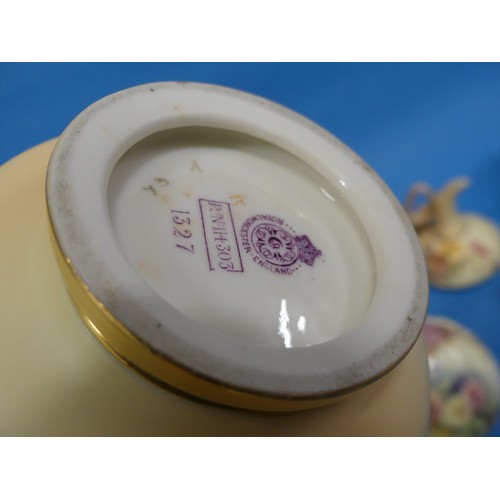 49 - A Royal Worcester twin-handled Blush Ivory Vase, with serrated edge, 1327 shape, 9in (23cm) high, to...