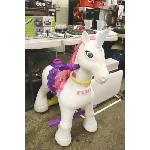 56 - FEBER RIDE ON UNICORN WITH CHARGER...