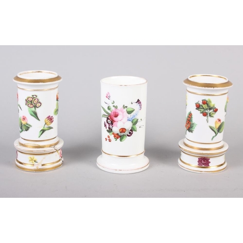 21 - A pair of Spode relief and floral decorated spill vases, 4 1/4