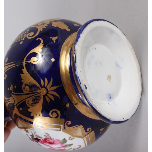 25 - A 19th century bone china bulbous vase, decorated with panels of flower on a blue and gilt ground, 8...
